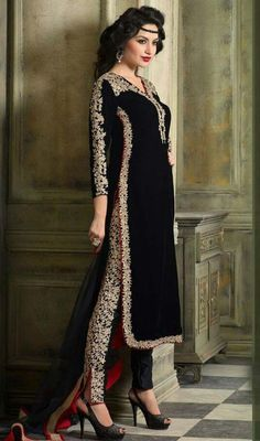 Mesmerize your onlookers in this black color embroidered velvet pant style suit. The desirable resham and stones work across the dress is awe-inspiring. #velvetdresses #indiandesignsuits #embroideredsalwarkameez