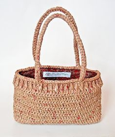 Crocheted bag from recycled grocery store bags.  No pattern, but something to try one day with another pattern.