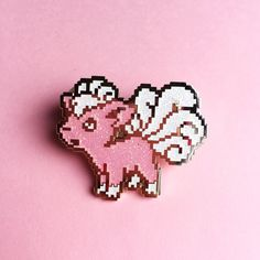 """8bit Vulpix pin; """"At the time of its birth, Vulpix has one white tail. The tail separates into six if this Pokémon receives plenty of love from its trainer. The six tails become magnificently curled."""""""