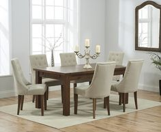 Buy the Normandy 180cm Dark Solid Oak Extending Dining Table with Pacific Fabric Dark Oak Leg Chairs at Oak Furniture Superstore