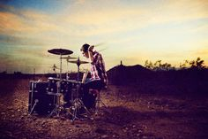 """Like that this photo is more about the """"sound"""" the drums are producing, and less about the drummer. Love the color and unexpected location. Moody. Hoping to avoid any typical """"band"""" type of shots and always be unexpected with the imagery."""