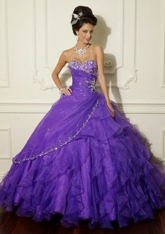 It is a dress for quinceaneras who like to be fashionable is a purple dress with silver glitter decorasiones has a silver necklace and a nice aregro his head is very cheap price  are two hundred eighty
