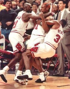 Rodman fighting as Jordan and Pippen hold him back.