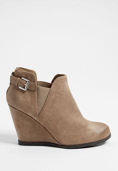 <ul><b>Overview</b><li>soft faux suede</li><li>side buckle detail</li><li>functional zip up back</li><li>gore sides have stretch</li><li>lightly padded footbed</li><li>solid heel</li></ul><ul><b>Sizing</b><li>3 1/2 inch heel</li></ul><ul><b>Fabric and Care</b><li>Style Number: 86341</li><li>Imported</li><li>Man made materials</li><li>Wipe clean</li></ul>