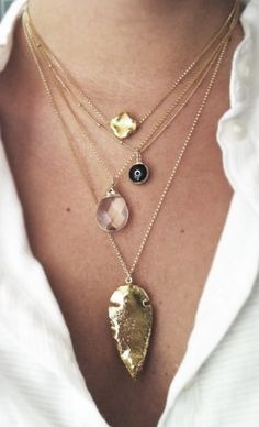 Layered gold necklaces - arrowhead, evil eye