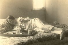 Woman smoking opium, said to be Shanghai in the 1920s.