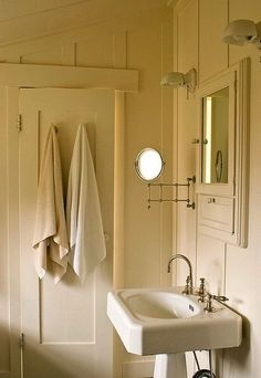 Cream and white vintage powder room; Ruby Gatta