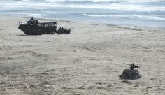 An unmanned aerial vehicle launches from a multi-utility tactical transport vehicle after exiting an autonomous assault amphibious vehicle during the Ship-to-Shore Maneuver Exploration and Experimentation (S2ME2) Advanced Naval Technology Exercise (ANTX) 2017 at Marine Corps Base Camp Pendleton, Calif. US Navy Photo