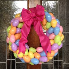 Saturday morning crafting! Wrap the 12inch styrofoam form in 3 yards of ribbon. Super glue eggs in alternating directions (I used 84 eggs and another 3 yards of ribbon for the bow)