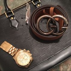 GUCCI belt Authentic Gucci brown leather belt with silver GG emblem new with tags. Minor scratch as seen in photo but not seen once the belt is on because once you loop through the other end of the belt covers it. Bought at Saks in Long Island and in Saks box with original gift receipt. Gucci Accessories Belts