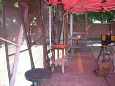 Inside of outdoor tent set up, by Texas Trash and Treasures