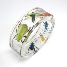 Acrylic bracelet with beetles.