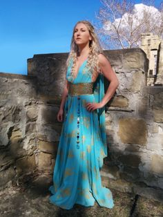 Daenerys Targaryen - Game of Thrones! #cosplay. Taffeta, hand silk screened with over 400 golden dragons, and made to an original pattern. Accessories are guided leather, and glass beads.