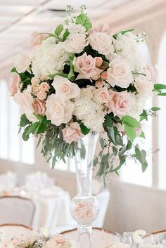 39 Gorgeous Tall Wedding Centerpieces tall wedding centerpieces in a transparent glass vase white flowers and ruddy roses with greens amy rizzuto via instagra. Blush Centerpiece, Pink Wedding Centerpieces, Wedding Flower Arrangements, Wedding Bouquets, Wedding Decorations, Centerpiece Ideas, Trumpet Vase Centerpiece, Tall Flower Centerpieces, White Flower Arrangements
