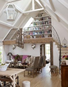 LOVE - wood tone, rought iron rail, curved stair, vaulted ceiling, bookcase...