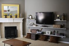 Wall mounted TV with underneath shelves