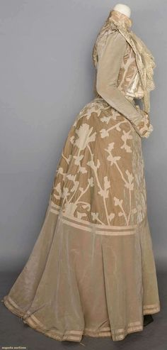 """Velvet and wool afternoon gown, circa 1902: 2-piece, taupe moire silk faille and velvet w/faun wool flannel appliques in stylized foliage motifs, bolero style bodice, high neck """"under bodice"""" of cream silk panne, ribbon embroidered, and lace trimmed lapels with lace jabot."""