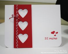 handmade Valentine card from In My Creative Opinion: Clean & Simple Card Making  ... crisp and bright look ... deep red and white ... column of red with three negative space hears ... baker's twine wrap ... simple sentiment stamped in scarlet ...  luv it!