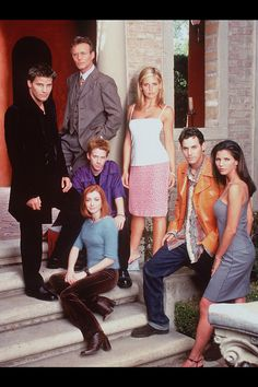 BUFFY THE VAMPIRE SLAYER: Clockwise from left: Angel, Rupert Giles, Buffy Summers, Xander Harris, Cordelia Chase, Willow Rosenberg, Oz   - HarpersBAZAAR.com