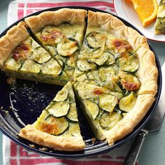 Cheesy Zucchini Quiche Recipe -A few years ago, I found this zucchini brunch recipe that's quick to prepare and freezes well, too. Just put it in the refrigerator to thaw overnight and pop it into the oven when you wake up! —Karen Howard, Lakeville, Massachusetts