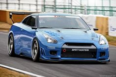 GT-R 35. Simply put a giant killer. Porsche put a car costing 3 times as much round the ring in 7.18 using Timo Kluck and race tyres, 7.24 with a leser driver. Nissan managed it in the wet in 7.24 and 7.29 with a stock car and tyres in 09.