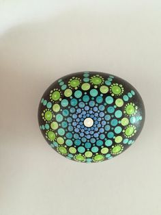 A personal favorite from my Etsy shop https://www.etsy.com/listing/465059876/mandala-stone-hand-painted-rock-dot