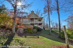 4 bed, 3.5 bath custom built home offers an open floor plan with cathedral ceiling w/ exposed beams,crown molding, stacked stone wood burning fireplace, wood floors, wet bar & icemaker, large kitchen w/ s.s. appliances, large pantry,master on main level w/ sitting area, master bath w/ large tiled shower/tub, french doors to covered decks w/ lake and mtn views, large open air party deck w/ stone fire pit, coffer ceiling, huge storage/workshop area.For info email: info@bestmountaindeals.com