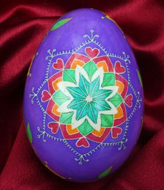 Purple goose egg with hearts and flowers