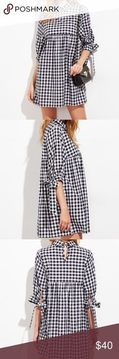 ASOS black & white check mini dress Peter Pan collar baby doll dress in Black & white buffalo check fabric. Cute tie detail on sleeves. Bust is 30 inches across front & length is 35 inches from shoulder to hem. ASOS Dresses Mini