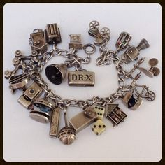 Rare Articulated Mec  Rare Articulated Mechanical Vintage Art Deco Charm Bracelet Sterling from antiquejewelryexpo on Ruby Lane