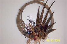 Rope wreath with pheasant feathers...