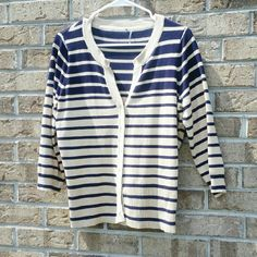Striped Cardigan Striped Cardigan  Size L Button down  77% Rayon 33% Nylon My eyes see navy and tan in this cardigan, so that is what I'm going with. Sweaters Cardigans