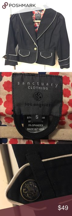 Sanctuary Structured Black Jean Jacket - Small Adorable structured jean jacket / blazer in black with white piping and emblem button, from Sanctuary Clothing Los Angeles. Size Small, pretty floral lining, 97% cotton, 3% spandex. Very cute for spring and fall over a dress or with slacks or a skirt! Sanctuary Jackets & Coats Jean Jackets