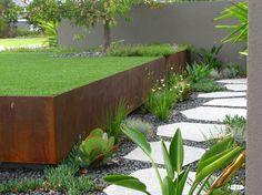 Fabulous Retaining Wall decorating ideas for Delightful Landscape Industrial design ideas with cor-ten grass gravel lawn path pavers retaining wall split-level steps succulents turf