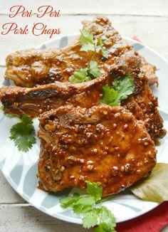 These Peri-Peri Pork Chops are made in a skillet, in a delicious, spicy, hot Peri-Peri Tomato Sauce