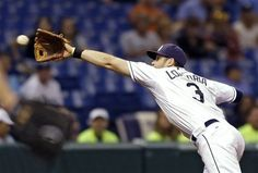 Tampa Bay Rays third baseman Evan Longoria catches a sixth-inning line drive by Baltimore Orioles' Manny Machado during a baseball game, Monday, Oct. 1, 2012, in St. Petersburg, Fla.