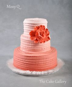 Wedding Cake Photos | The Cake Gallery Omaha. coral peach ombre cake with coral or orange flower focal point
