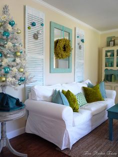 Shabby Chic - reclaimed shutters and mirror behind the couch. (The turquoise and green Christmas decor is nice, too!) Flea Market Trixie via House of Turquoise. ---This screams @Jessica Pribil