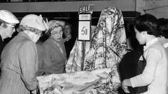 1956: Women looking at fabric in John Martin's department store in Adelaide.