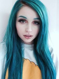 love the blue hair and her makeup just not digging the blue eyebrows