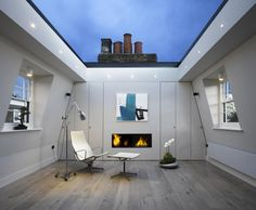 Beautiful, ultra-modern roof-deck nested in the skin of an old building's attic.  Retractable roof.