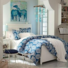Engaging Girl Bedroom Idea for Teen with White Wooden Bed Frame and Chic Blue Paisley Comforter Set and White Nightstand also Chic Iron Chair and Table and Pastel Color Painted Wall and Sleek Floor Tile