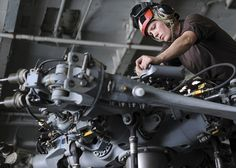 """GULF OF OMAN (Aug. 26, 2013) Aviation Machinist's Mate Airman Lauren Houk, from St. Charles, Mo., conducts daily inspections on an MH-60R Seahawk helicopter assigned to the """"Wolf Pack"""" of Helicopter Maritime Strike Squadron (HSM) 75 in the hangar bay of the aircraft carrier USS Nimitz (CVN 68). Nimitz Strike Group is deployed to the U.S. 5th Fleet area of responsibility conducting maritime security operations, theater security cooperation efforts and support missions for Operation Enduring…"""