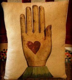 Primitive heart in hand pillow