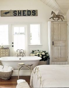 I love the tub next to the bed!  Im sure the bath robe is in the closet.   BATH,ROBE, Then BED. Perfect.