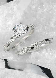 This platinum engagement ring features a delicate twist of pavé-set diamonds that will complement the center diamond of your choice.