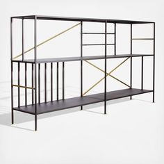 The New Prairie Horizontal Bookcase by Sauder Boutique features a black textured powdercoated metal frame with metal-plated brushed bronze accent tubing.
