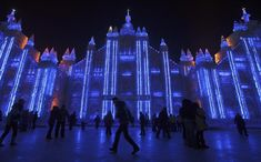 Visitors attend the opening of the Harbin Ice and Snow Festival in Harbin, China on Monday, Jan. 5, 2009