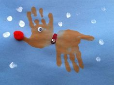 Use two handprints to make reindeer as a Christmas art project!