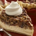 Cheesecake meets pecan pie in this smooth and decadent seasonal dessert. Vanilla Pecan Pie 1 refrigerated pie crust (, (from 14.1-ounce package))1 package ((8 ounces) cream cheese, softened)3 eggs (, divided)3/4 cup sugar (, divided)4 teaspoons McCormick® Pure Vanilla Extract (, divided)1/2 cup light corn syrup3